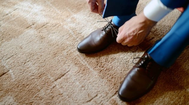 Man Tying Up Leather Dress Shoes
