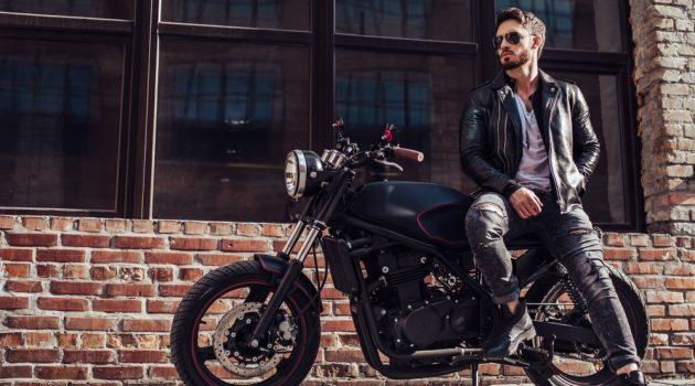 Man in Leather Jacket Posing Against Motorcycle
