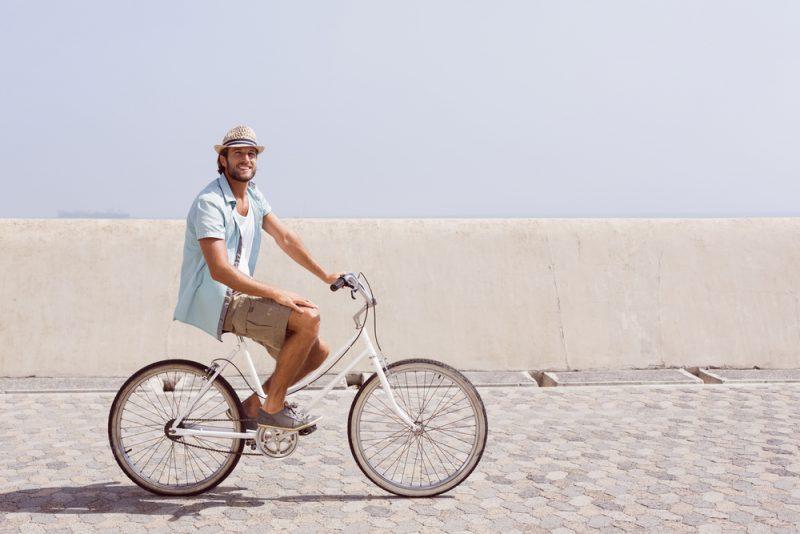 Man in Straw Hat Riding Bike