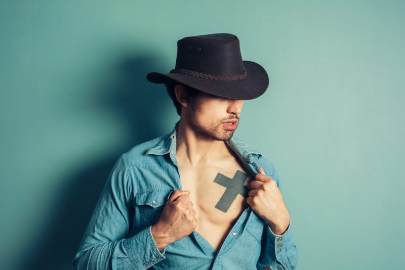 Man with Hat and Tattoo