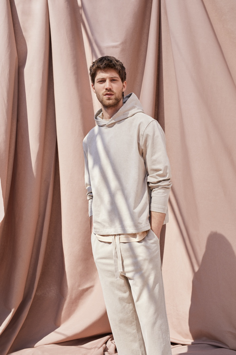 Front and center, Boyd Gates wears a t-shirt, hoodie, and more from Mango Committed's Mineral Dyes capsule collection.