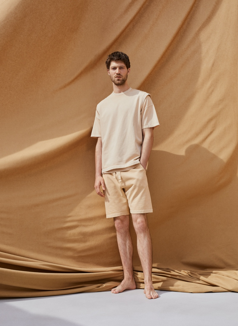 A casual vision, Boyd Gates models a vest, t-shirt, and shorts from Mango Committed's Mineral Dyes capsule collection.