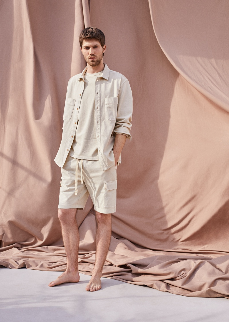Embracing monochromatic style, Boyd Gates sports a spring look from Mango Committed's Mineral Dyes capsule collection.