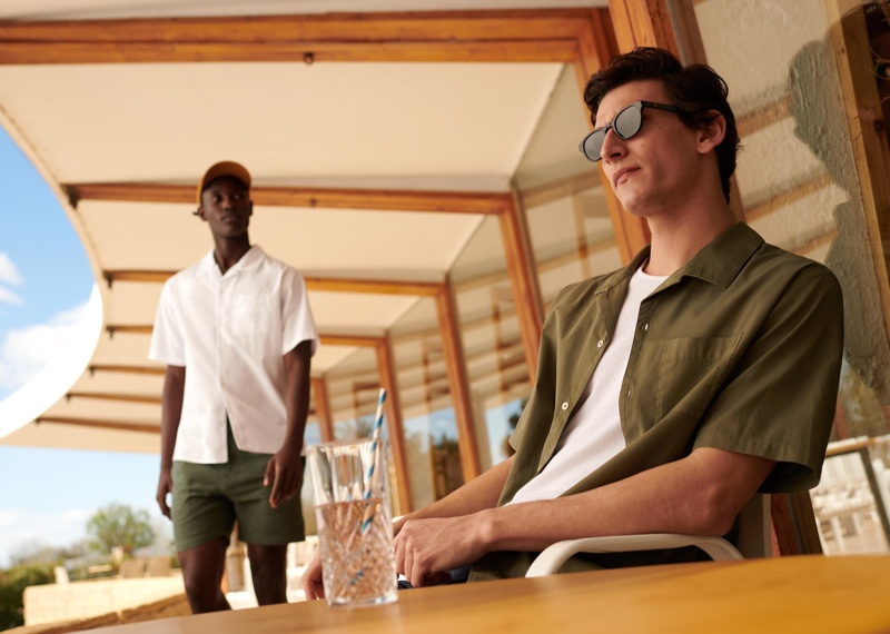 Models Charles Oduro and Thibaud Charon don Cuban-collared short-sleeve shirts from Octobre's new Motel Paradise collection.