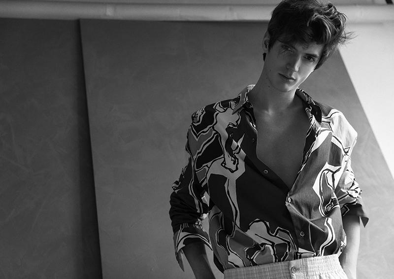 Embracing a graphic print, Ollie Greb dons a Hermès shirt.