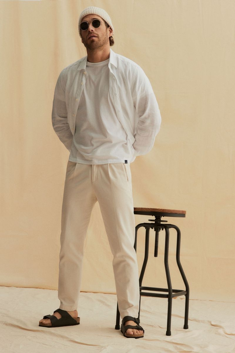 Embracing neutral tones, Simone Bredariol wears a spring look from Seventy Venezia.