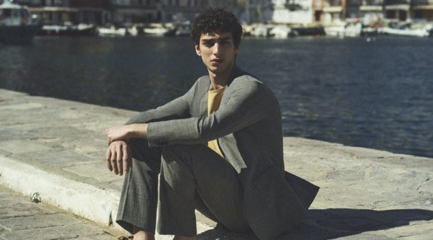 Donning a trim suit, Qaher Harhash stars in Theory's spring-summer 2021 campaign.