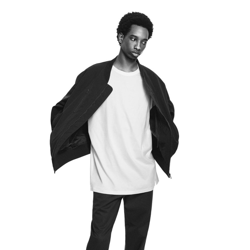 Benoit Michel sports a bomber jacket and tee for UNIQLO +J's spring 2021 campaign.