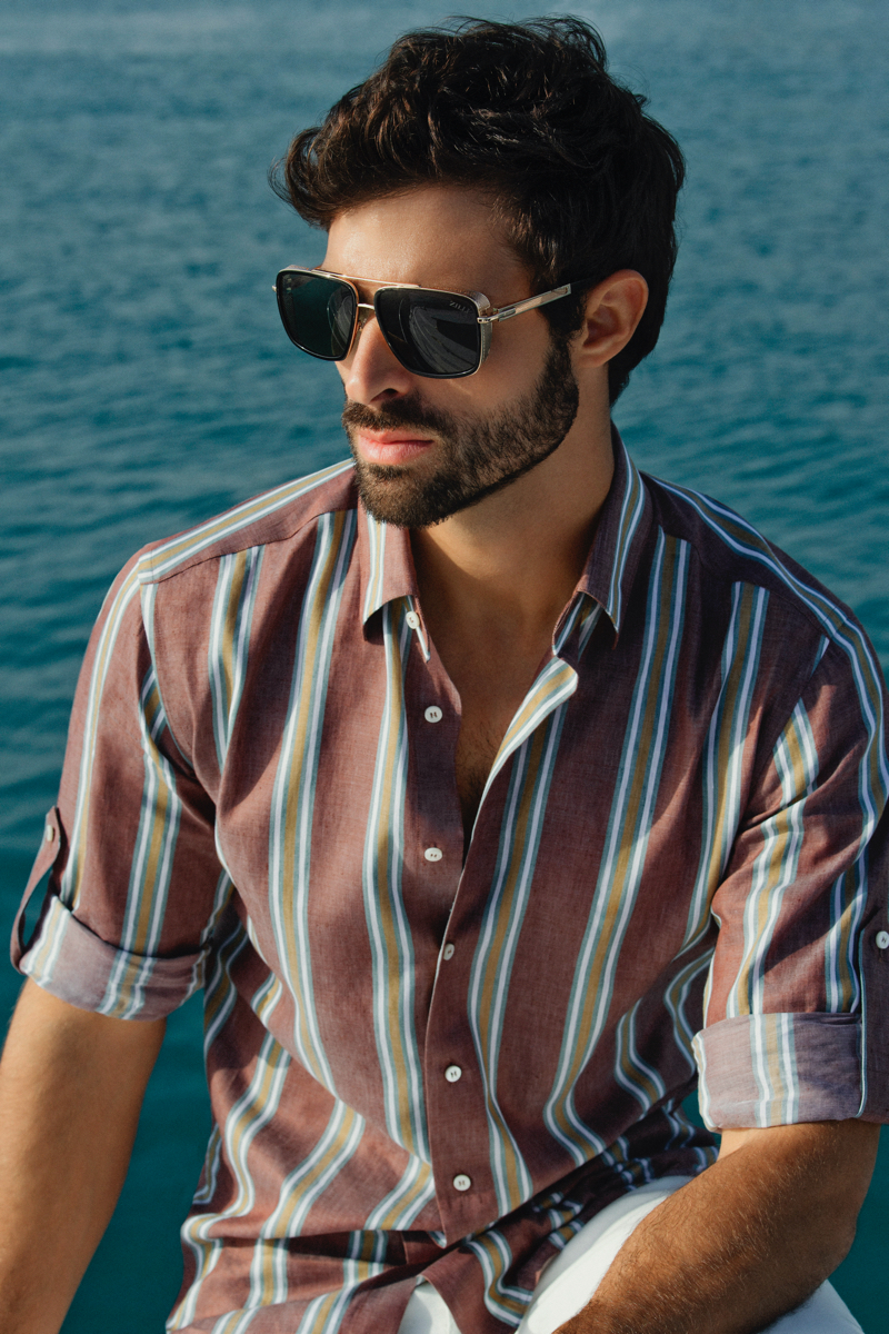 Sporting a striped shirt, Juan Betancourt stars in ZILLI's spring-summer 2021 campaign.