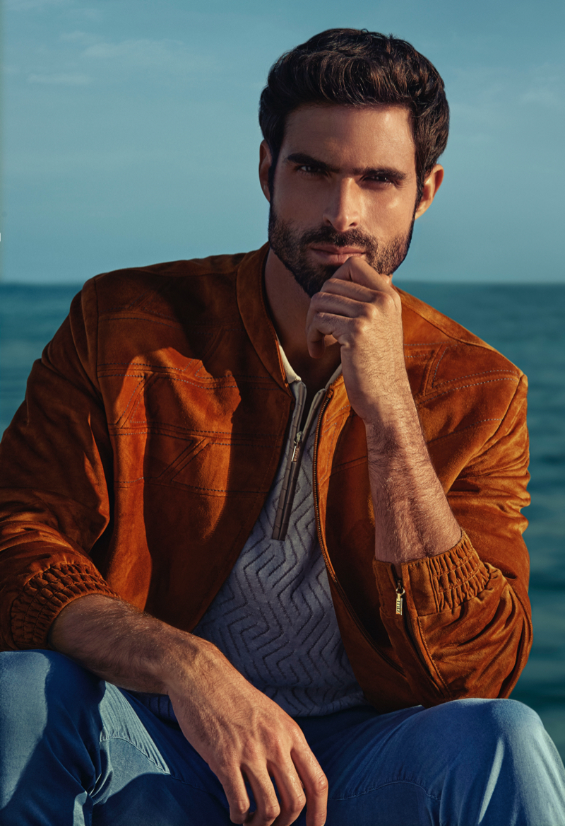 Front and center, Juan Betancourt dons a suede jacket for ZILLI's spring-summer 2021 campaign.