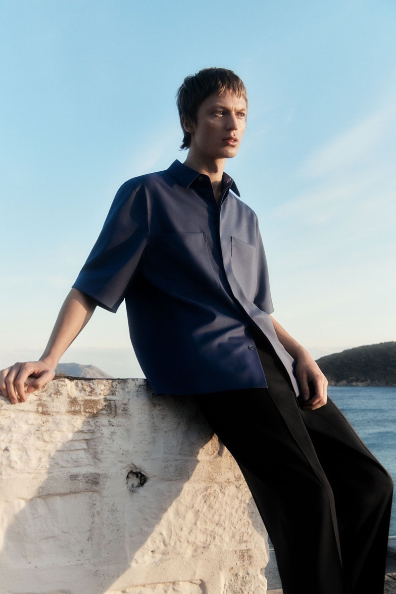 Jonas Glöer dons a patch pocket shirt with slim-fit trousers by COS.