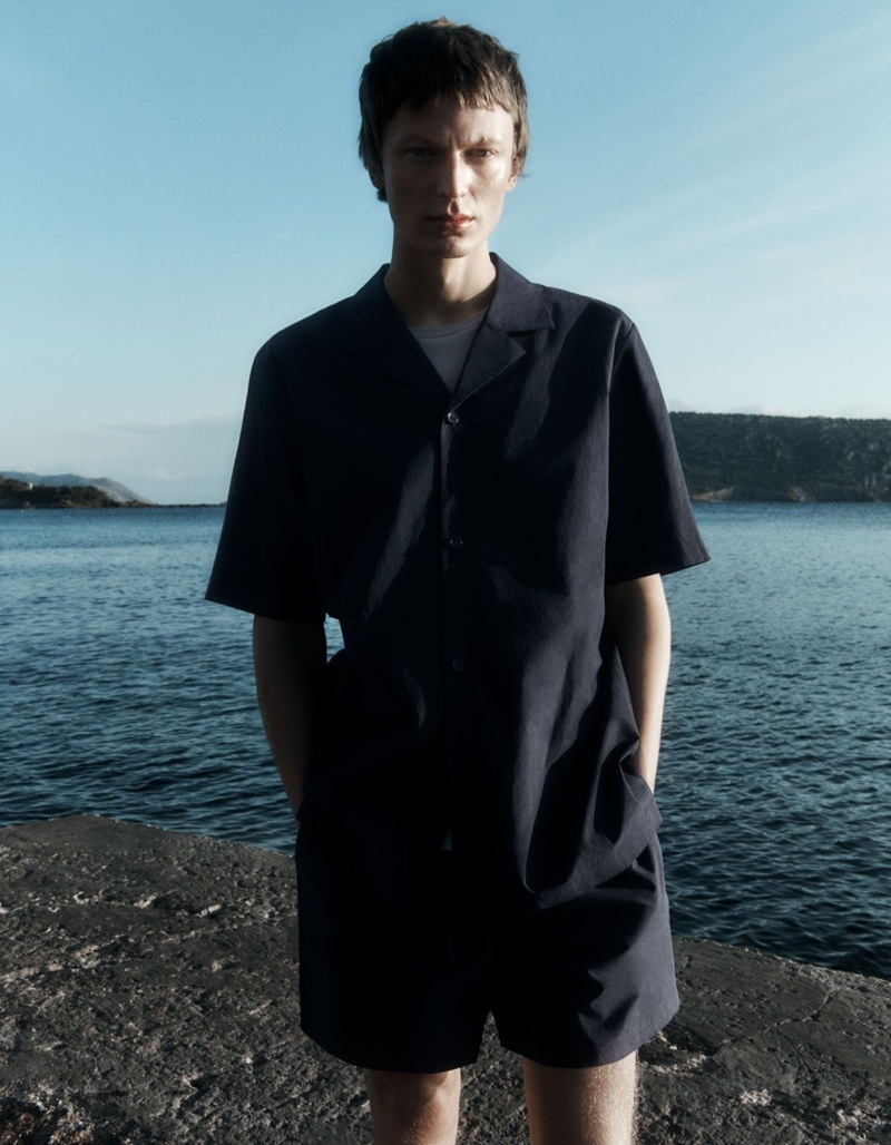 Reuniting with COS for summer, Jonas Glöer models a relaxed camp-collar shirt with drawstring shorts.