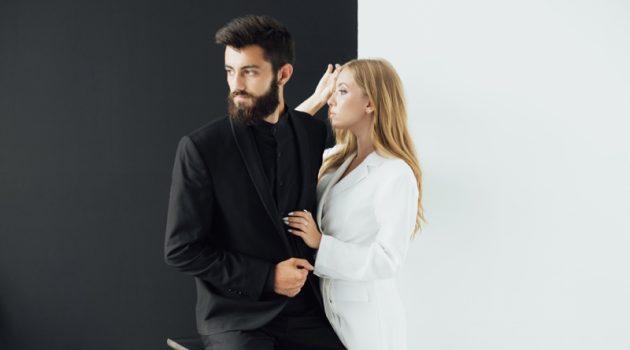 Couple Man Black Suit Woman White Outfit Concept