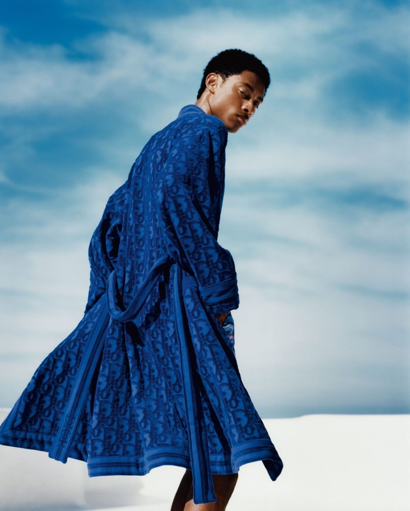 Eddie Wrey photographs Jecardi Sykes in a luxurious blue robe from Dior Men's 2021 beachwear capsule collection.
