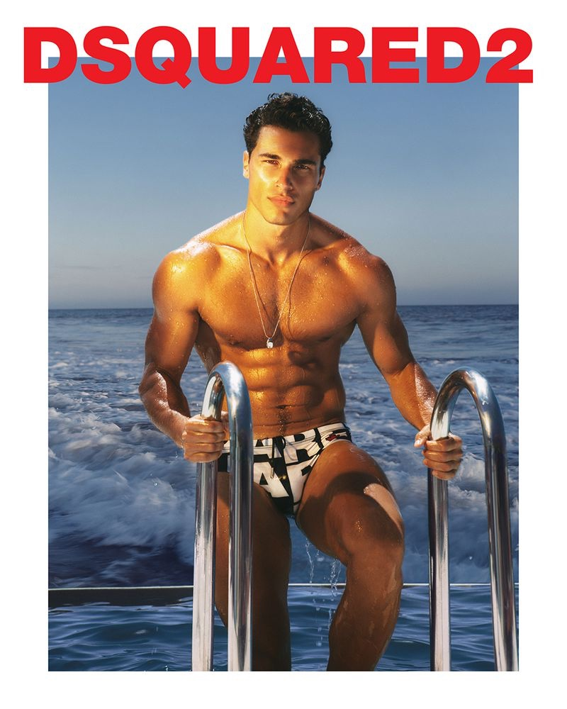Sporting a logo print swimsuit, Dean Perona fronts Dsquared2's 2021 beachwear campaign.