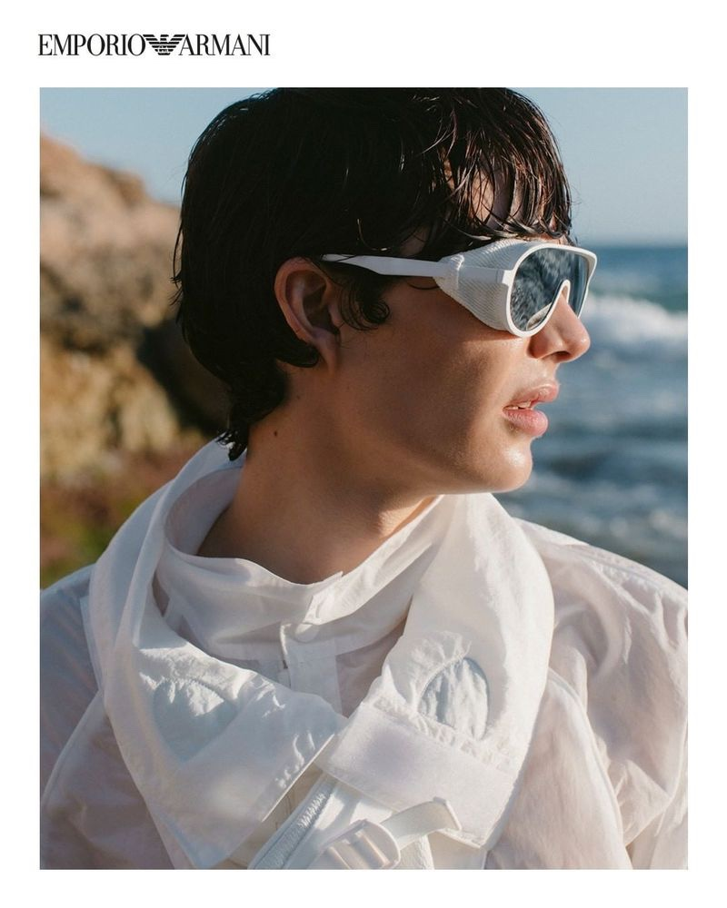 Sporting modern sunglasses, Hernan Cano wears a look from Emporio Armani's spring-summer 2021 sustainable capsule collection.