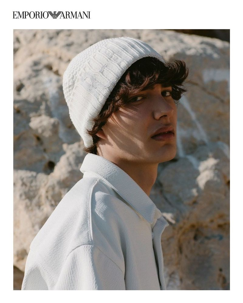 Front and center, Hernan Cano dons a knit beanie and jacket from Emporio Armani's spring-summer 2021 sustainable capsule collection.
