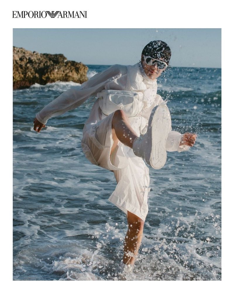 A vision in white, Hernan Cano models fashions from Emporio Armani's spring-summer 2021 sustainable capsule collection.