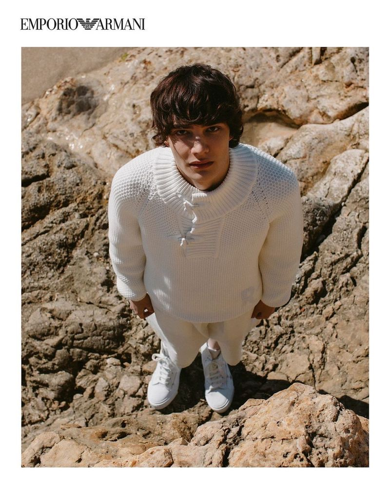 Stepping outdoors, Hernan Cano rocks a sweater from Emporio Armani's spring-summer 2021 sustainable capsule collection.