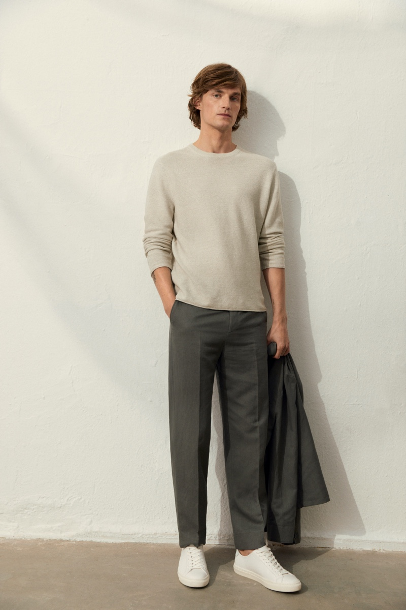 Charlie Westerberg dons a sweater and linen suit from Filippa K.