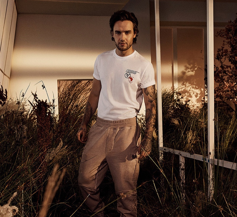Singer Liam Payne sports a planet artwork t-shirt with cargo pants from his spring-summer 2021 HUGO collection.