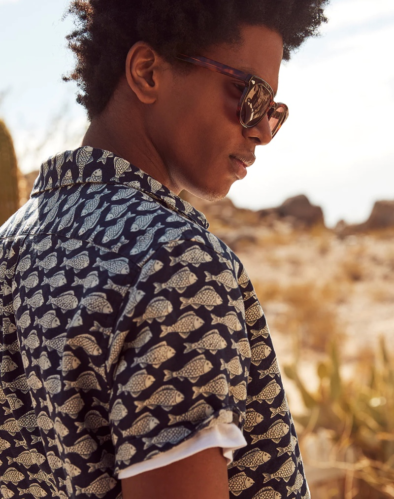 Rafael Mieses dons a J.Crew fish print linen short-sleeve shirt with Dock sunglasses.