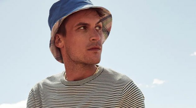 Miles Garber sports a J.Crew striped sweater with dock shorts and a reversible plaid bucket hat.