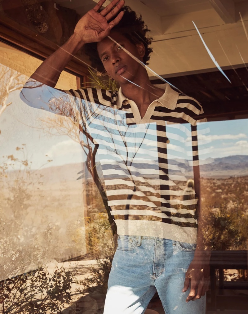 Front and center, Rafael Mieses sports a J.Crew short-sleeve striped Johnny collared polo with 1040 athletic-fit stretch jeans.