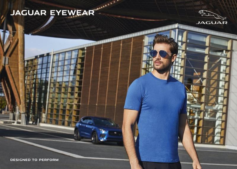 Stepping outside in aviator sunglasses, Baptiste Mayeux stars in Jaguar Eyewear's summer 2021 campaign.