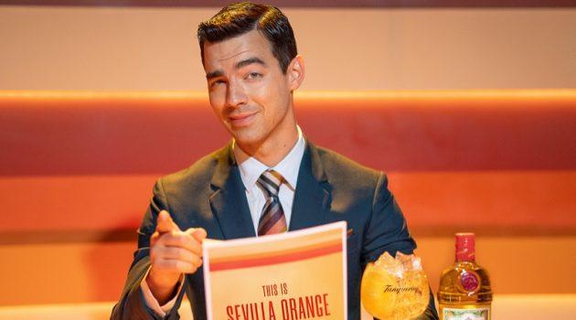 Joe Jonas plays a news anchor for the new Tanqueray Sevilla Orange campaign.