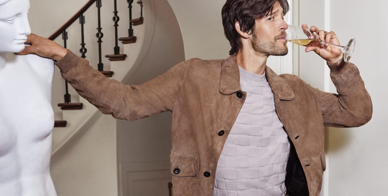 Josh Upshaw dons a brown suede jacket with a textured sweater from Giorgio Armani for Neiman Marcus.