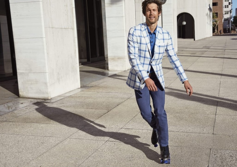 Rollerblading, Josh Upshaw inspires in a tailored ensemble from Kiton for Neiman Marcus.