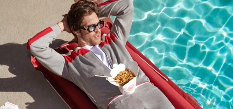 Relaxing poolside, Josh Upshaw wears Stefano Ricci for Neiman Marcus.