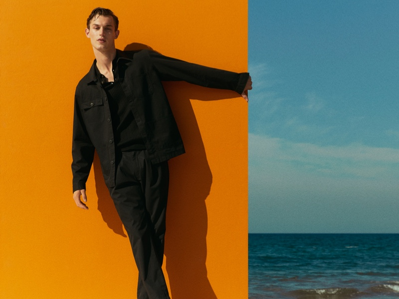 Donning all black, Kit Butler wears a chic look from Massimo Dutti.