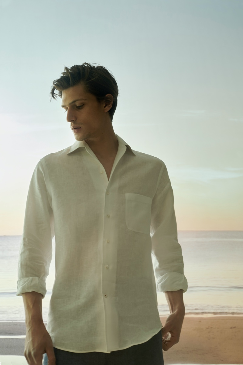 Model Edoardo Sebastianelli wears a linen shirt from the Loro Piana x Mytheresa capsule collection.
