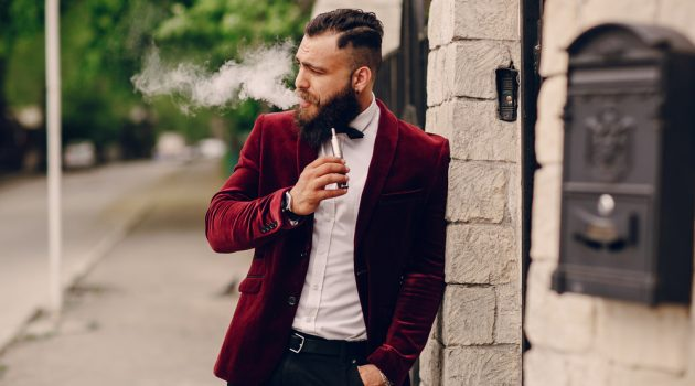 Man Vaping in Velvet Jacket