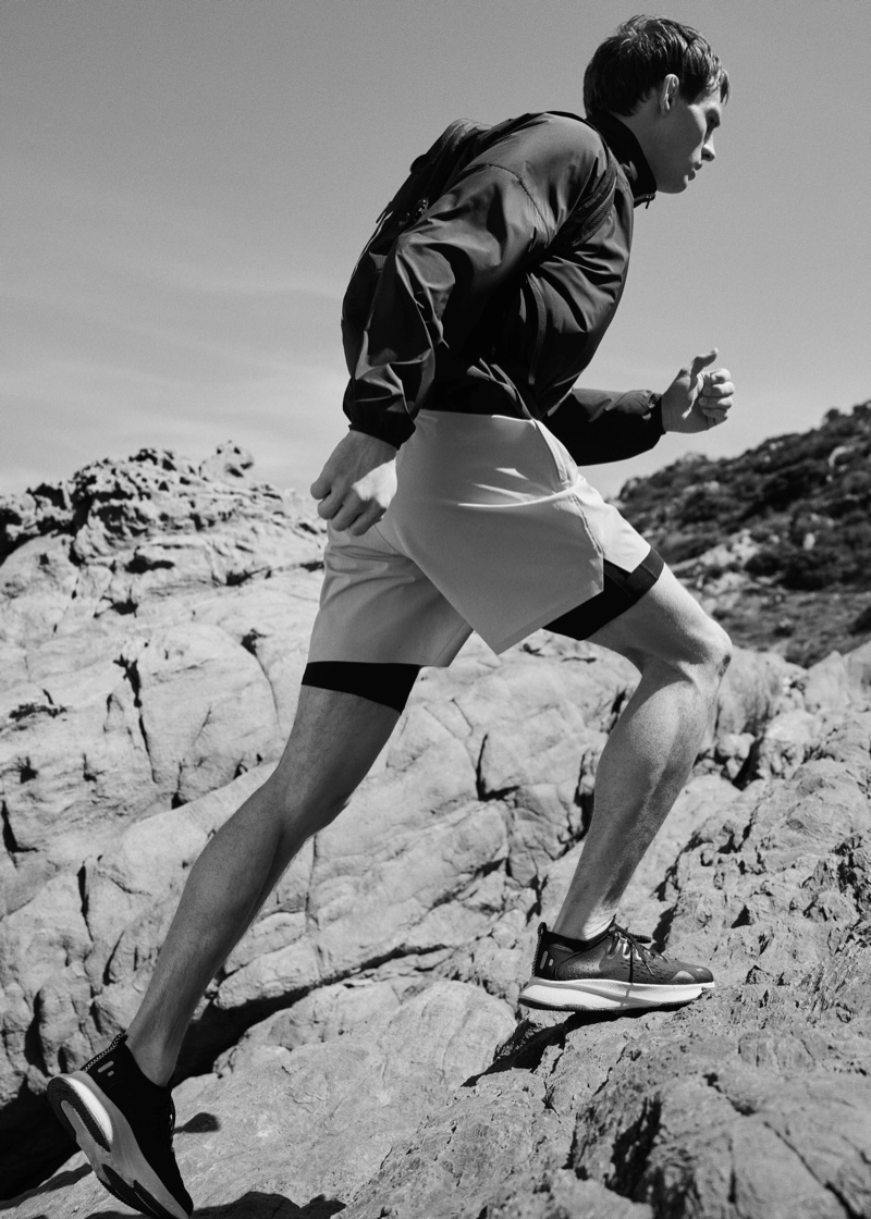 Appearing in a black and white image, Julian Schneyder models a sporty look from Mango Man's Active collection.