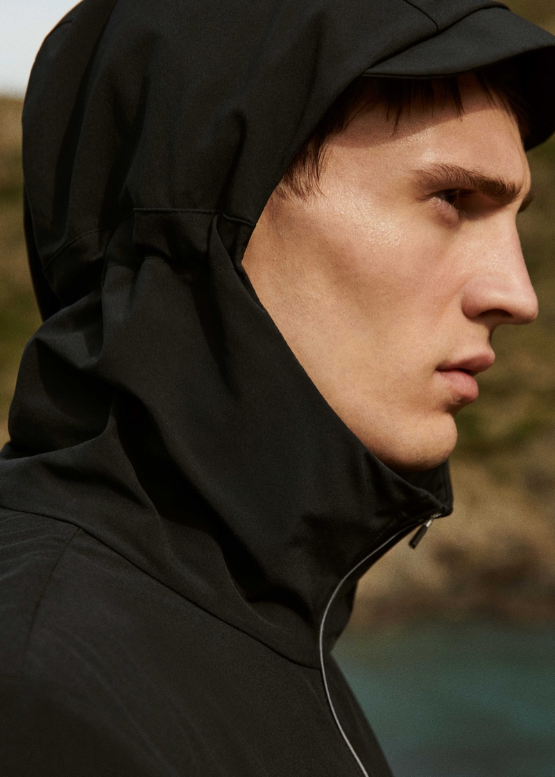 Serving up a side profile, Julian Schneyder rocks a jacket from Mango Man's Active collection.