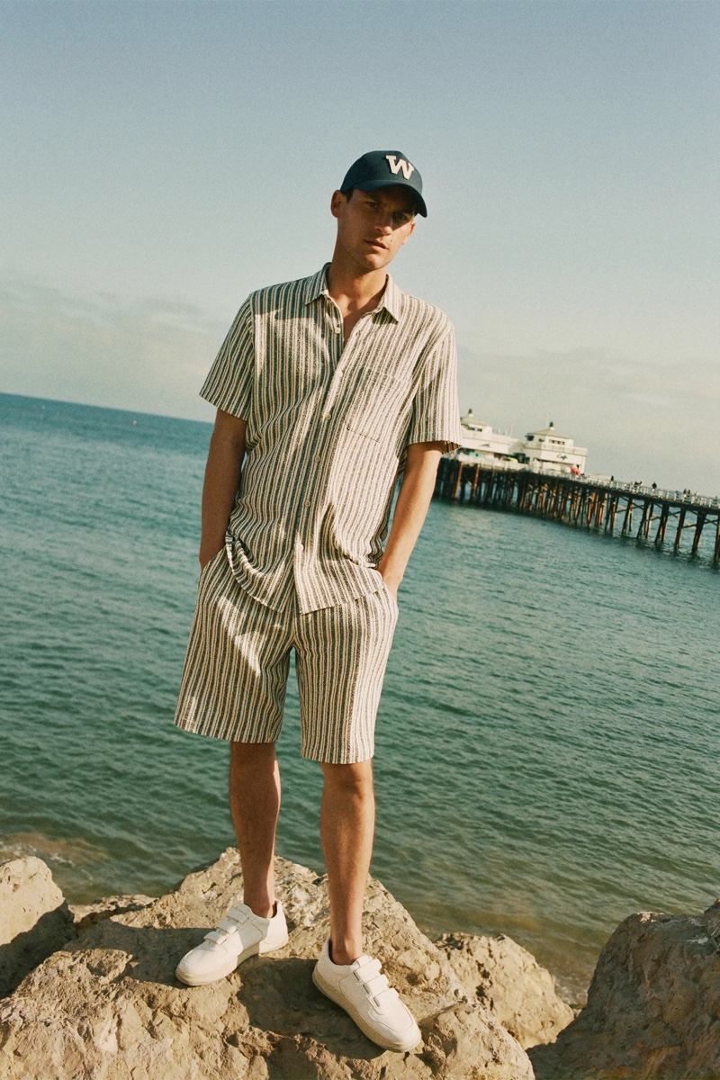 Miles Garber models a matching striped shirt and shorts with a cap from Zara.