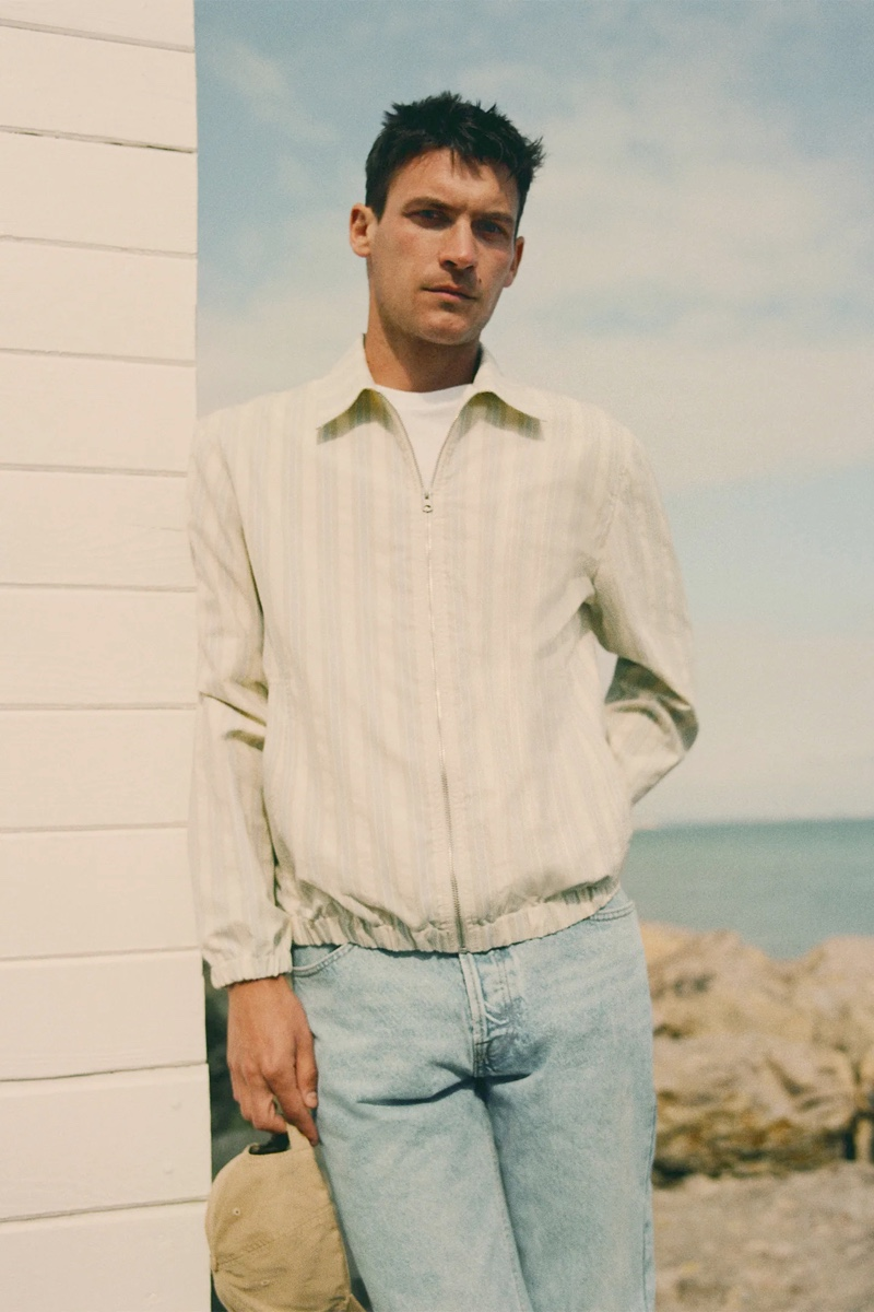 Going casual, Miles Garber rocks a striped jacket with light wash jeans from Zara.