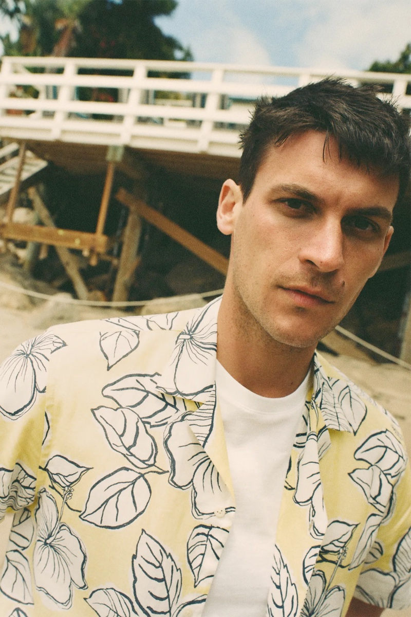 Making a graphic statement, Miles Garber dons a yellow shirt from Zara.