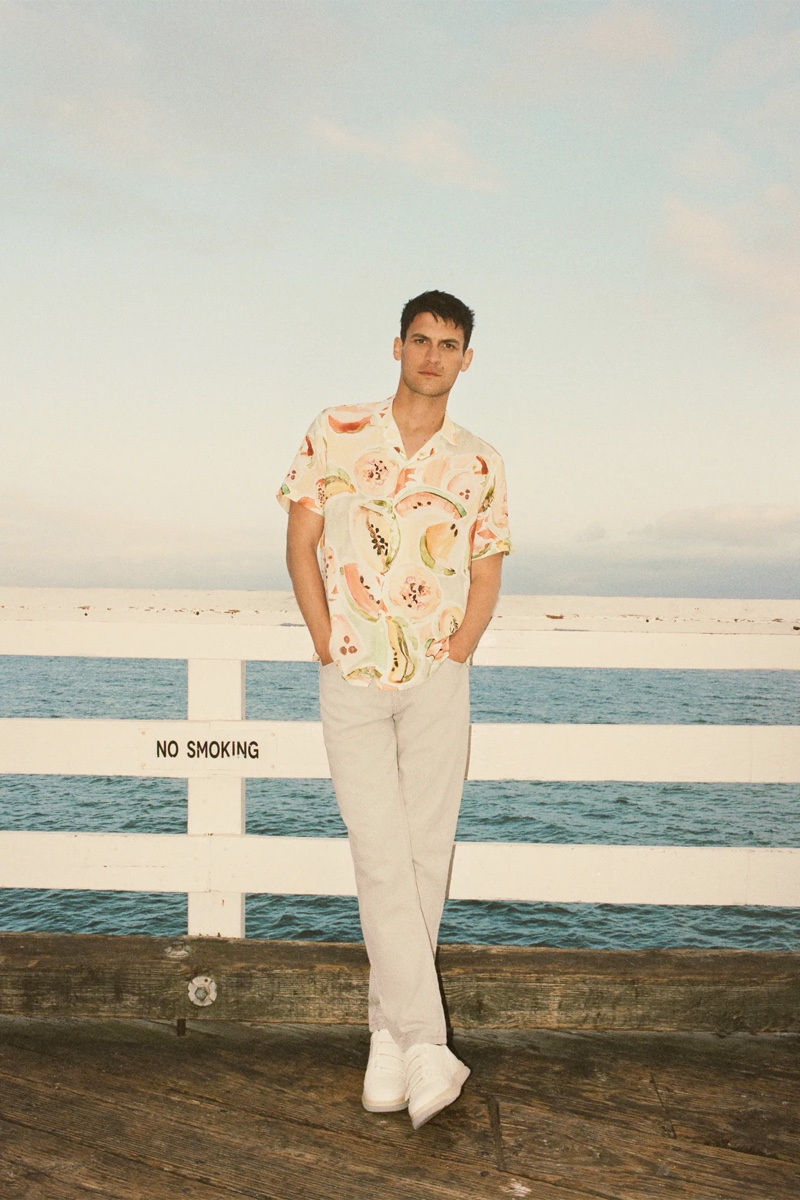 Front and center, Miles Garber dons a fruit print shirt from Zara.