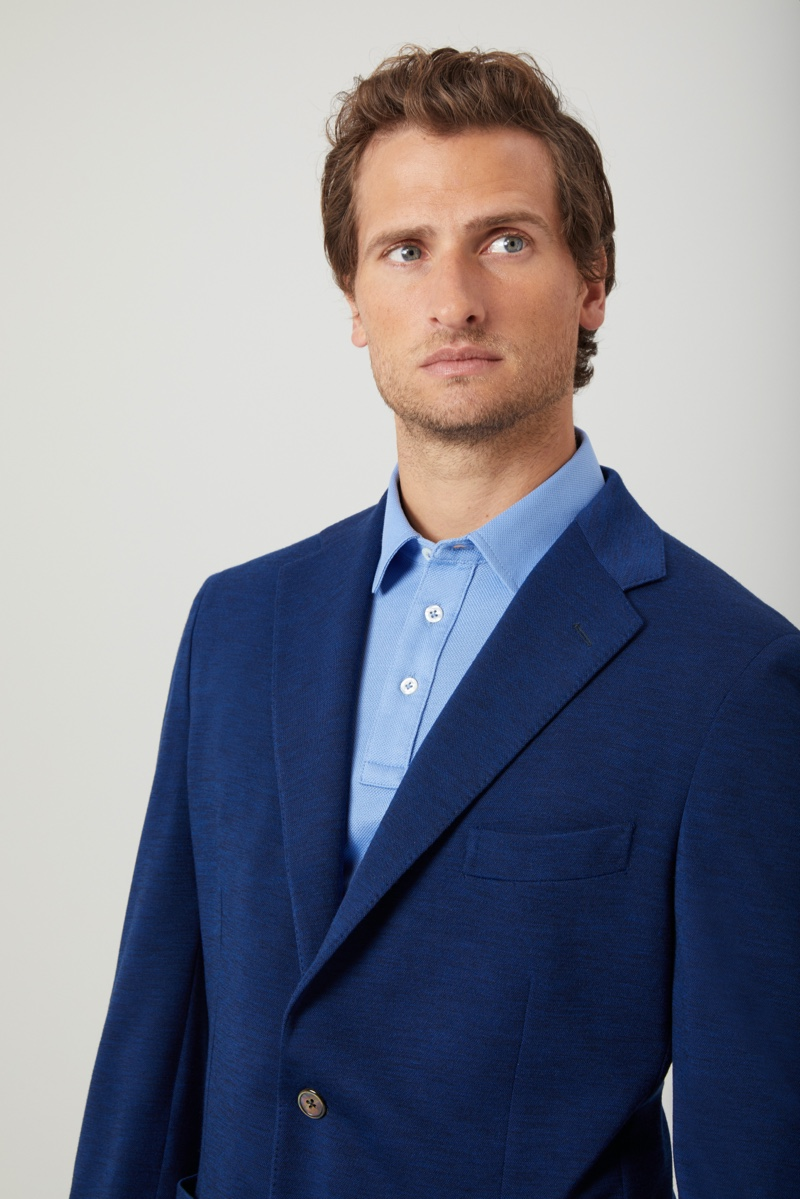 Tom Warren models a Niccolò P. London polo shirt with an upcoming blazer from the brand.