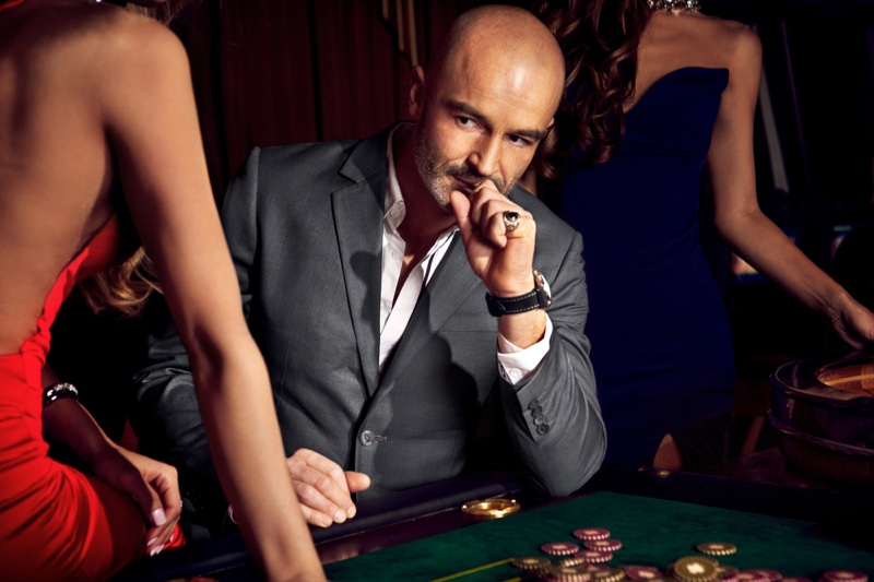 Older Man Grey Suit Casino Table Surrounded Women