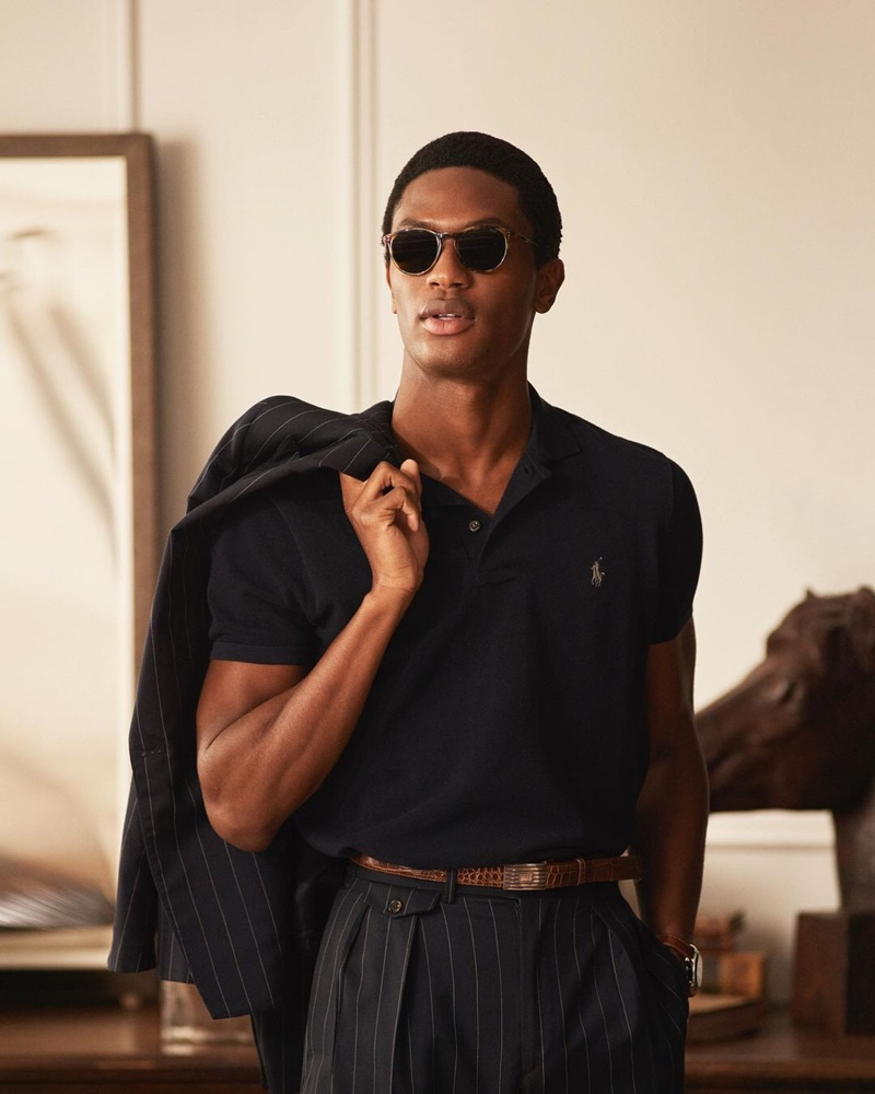 Hamid Onifade dons a chic pinstripe number from POLO Ralph Lauren's spring-summer 2021 collection.
