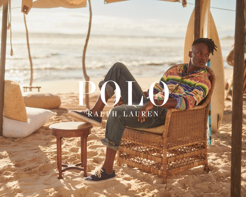 Sporting a colorful hooded pullover, Lwakhe Matiwane appears in POLO Ralph Lauren's Wild Coast collection campaign.
