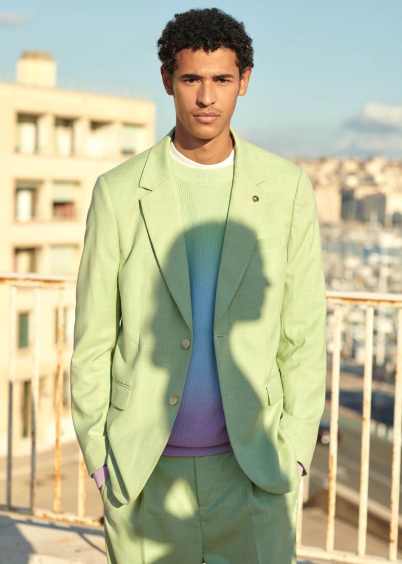 Kaissan Ibrahima stands out in a lime green suit from Scotch & Soda.
