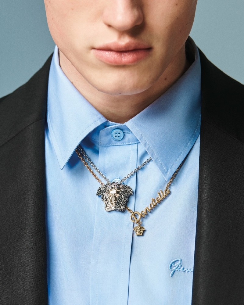Valentin Humbroich sports a necklace for Versace's spring-summer 2021 men's accessories campaign.