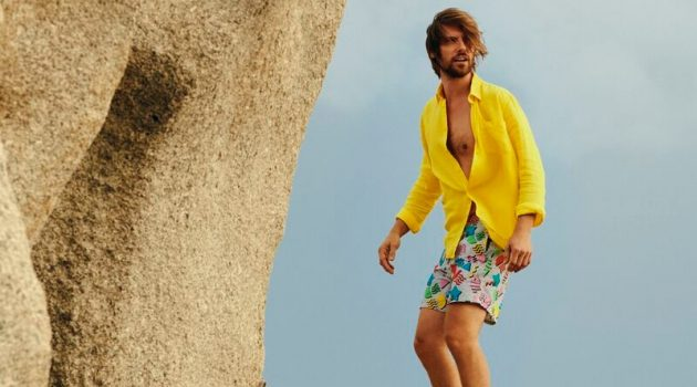 James Crabtree models a yellow shirt with Vilebrequin's 1986 Memphis swim trunks.