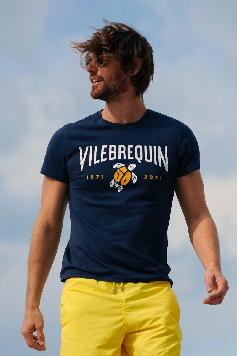 Model James Crabtree wears a VBQ 50 cotton t-shirt with Vilebrequin's solid lemon swim trunks.